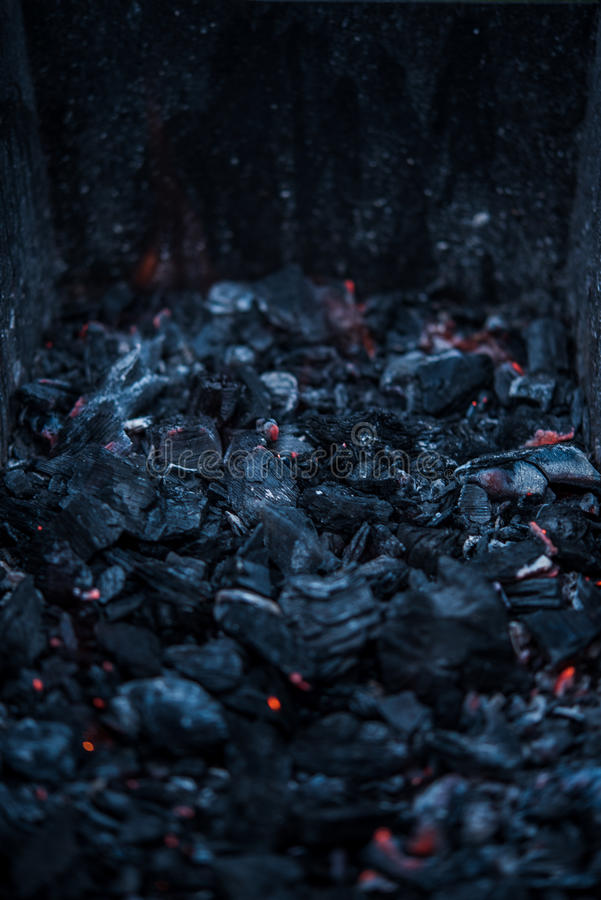 Smouldering coals at barbeque campfire royalty free stock photo