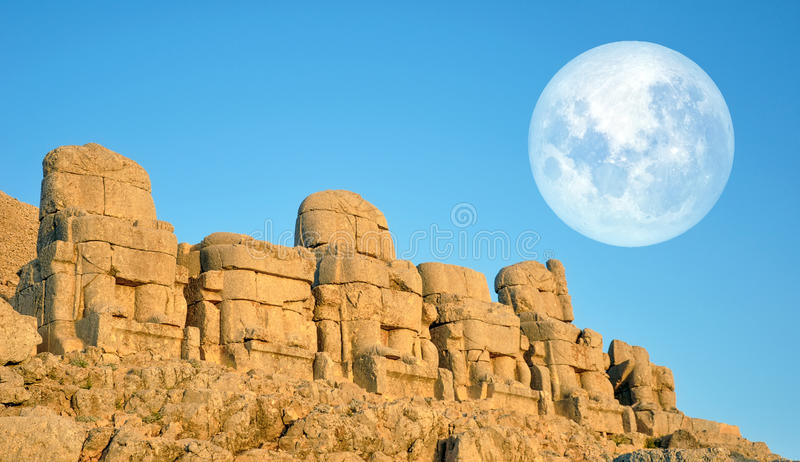 SMount Nemrut the head in front of the statues. The UNESCO World Heritage Site at Mount Nemrut where King Antiochus of Commagene i. Mount Nemrut the head in stock photo