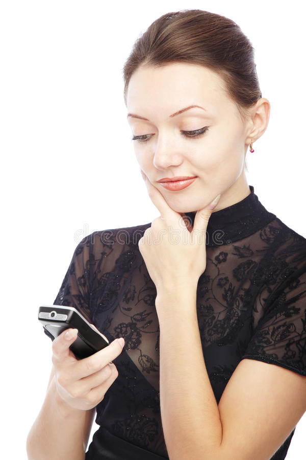 SMS. Thinking lady with cellphone reading SMS royalty free stock image