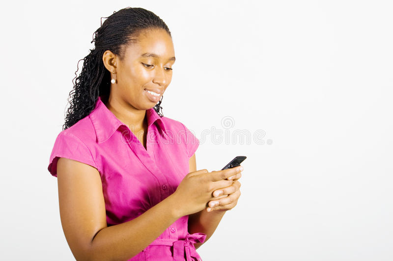 Sms. African woman reading text message sms on cellphone royalty free stock photos