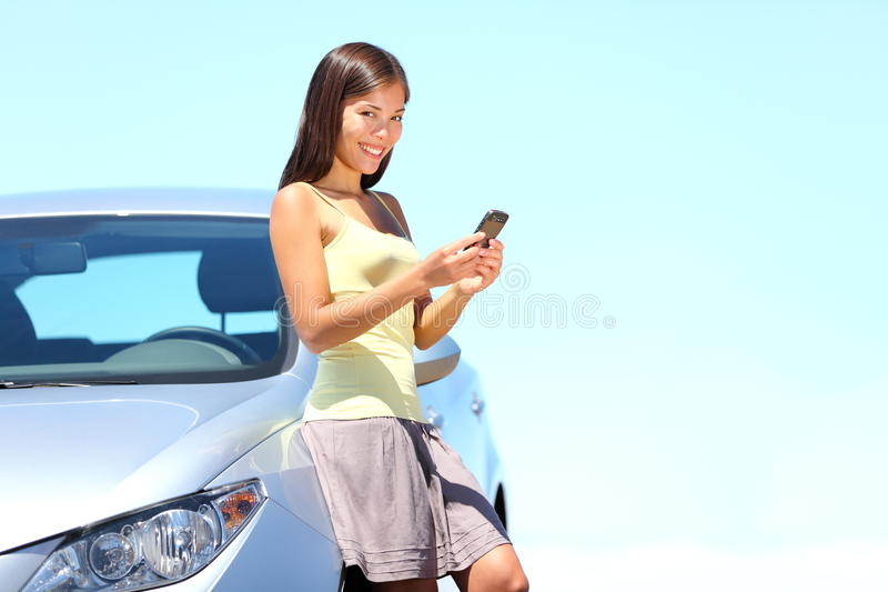 SMS Mobile phone woman by car royalty free stock photo