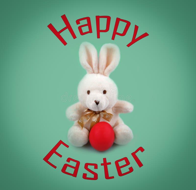 Smsa den lyckliga påsk- och påskkaninen med det röda ägget arkivfoton