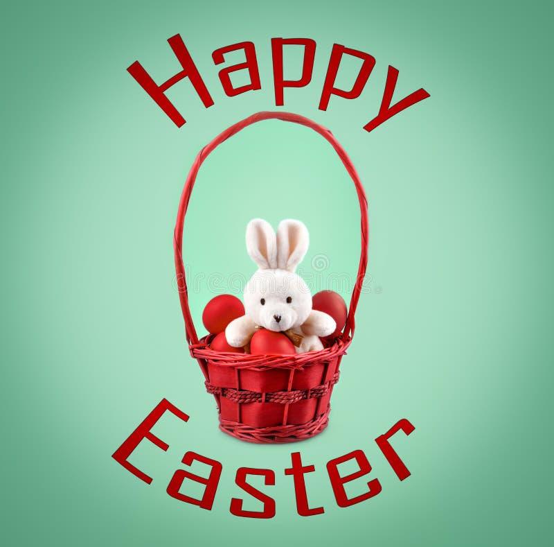 Smsa den lyckliga påsk- och påskkaninen med röda ägg i korgen royaltyfria foton