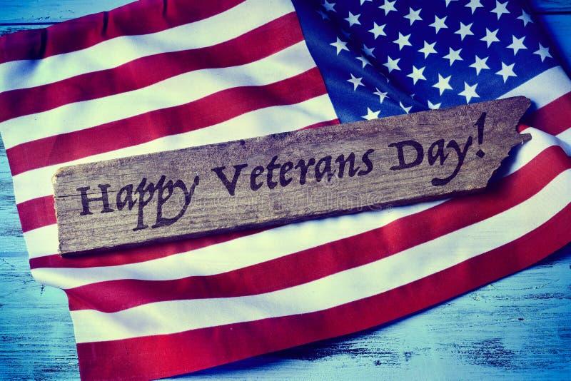Smsa den lyckliga veterandagen och flaggan av USA arkivbild