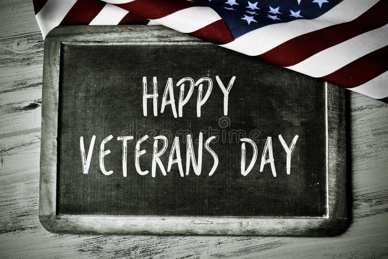 Smsa den lyckliga veterandagen och flaggan av USA arkivfoton