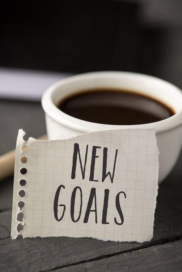 Smsa nya mål i ett stycke av papper royaltyfri bild
