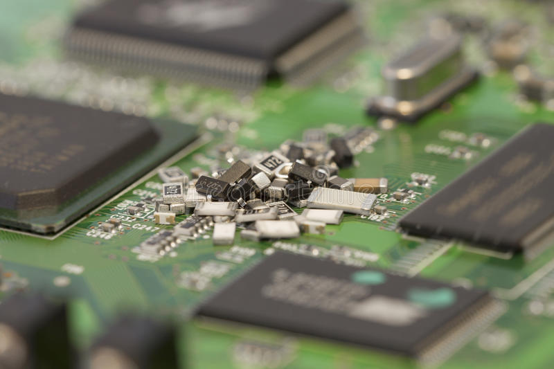 SMT closeup. Surface-Mount Technology components pile royalty free stock photos