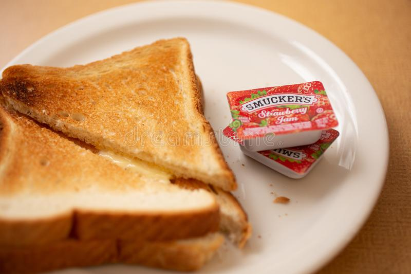 Smuckers jam and toast at a restaurant stock photos