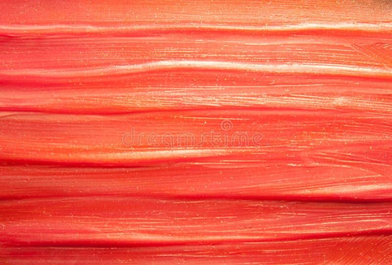 Smudged czerwona Burgundy pomadki pomarańczowa tekstura zdjęcia royalty free