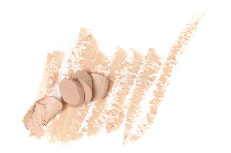 Smudged face concealer. Smudged and broken makeup concealer isolated on white background. Top view point royalty free stock image