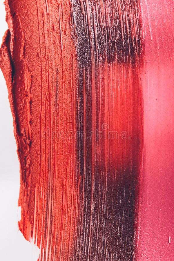 Smudged lipstick makeup artistry business strokes. Smudged lipstick. Makeup artistry business. Textured orange pink strokes. Creative background stock photos