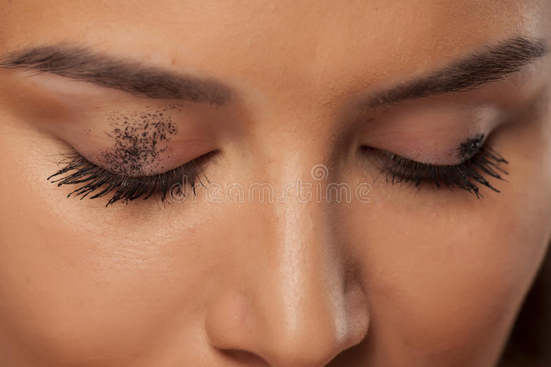 Smudged mascara. Mascara smudged on the eyelid. Make up concept royalty free stock photo