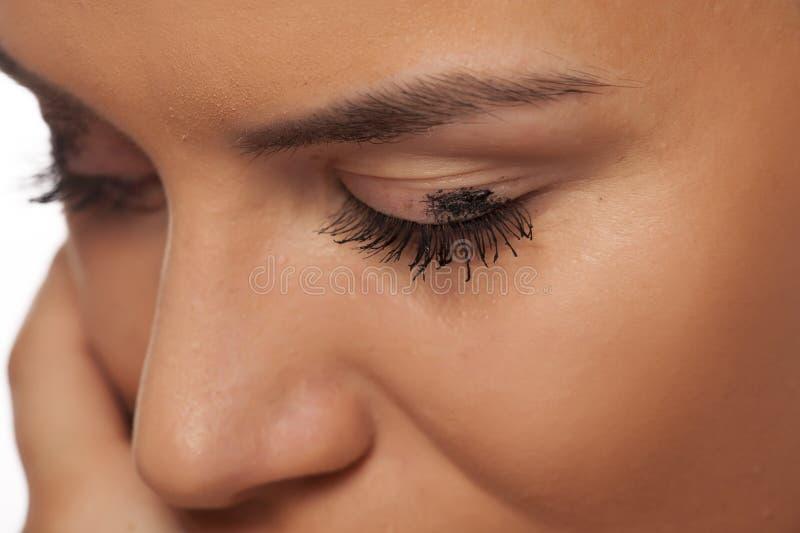 Smudged mascara. Mascara smudged on the eyelid. Make up concept royalty free stock photography