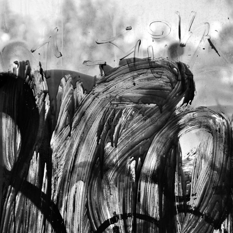 Smudged paint on glass. Abstract background. Black and white royalty free stock photography