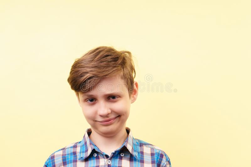 Smug cheeky daring boy with skeptical smile. Over yellow background, advertisement, banner or poster template, emotion, people reaction royalty free stock images