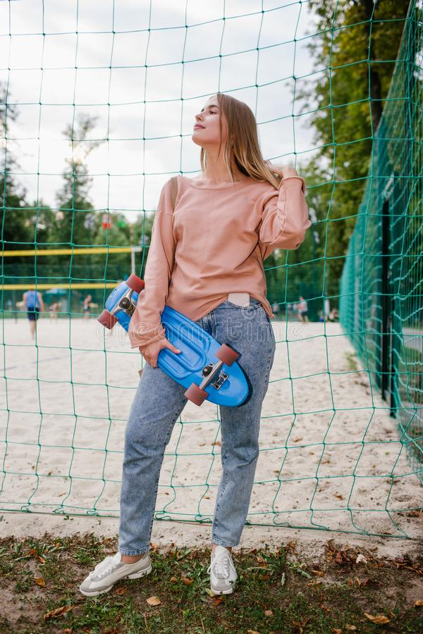 Smug skater girl urban sport youth lifestyle stock photos