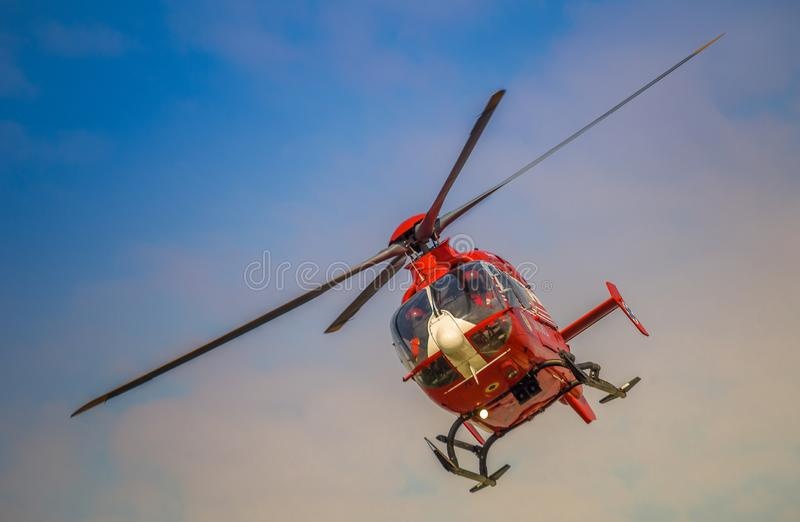 SMURD helicopter,Romania air ambulance. SMURD helicopter on the sky, romanian air ambulance airborne aircraft alarm arafat aviation blade care chopper color royalty free stock images