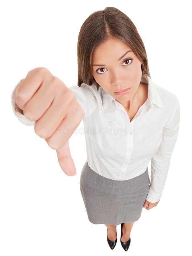 Smutna biznesowa kobieta robi kciuki zestrzela znaka zdjęcia royalty free