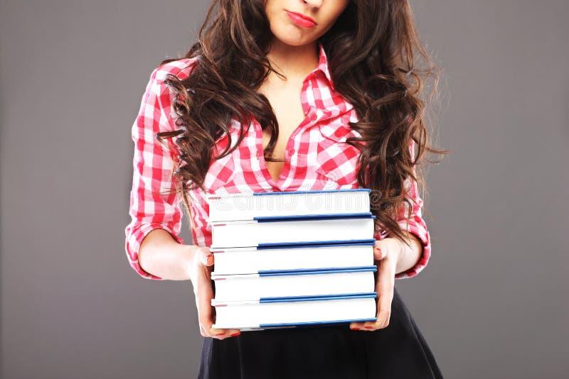 Smutna kobieta z książkami obraz royalty free