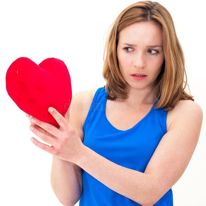 Smutnego kobiety mienia valentine czerwony serce zdjęcie royalty free