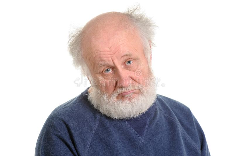 Smutnego przygnębiającego starego człowieka odosobniony portret fotografia royalty free