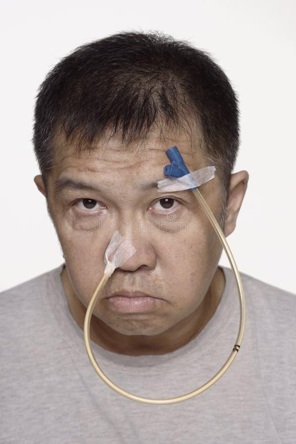 Smutny Chińczyk z portretem z rurki nosowej obrazy stock