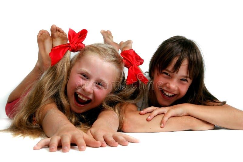 smutsiga flickor sular två royaltyfri foto