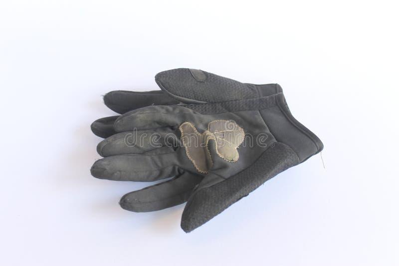 Smutsiga gamla svarta handskar arkivfoton