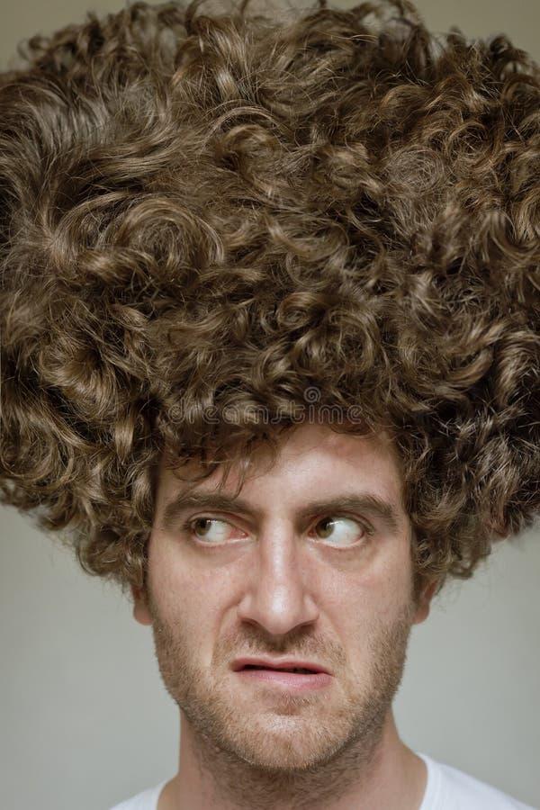 Smutsigt lockigt hår royaltyfri foto