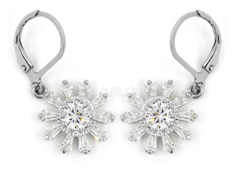 Smyckenörhängen - zirkon - rostfritt stål och kristaller royaltyfri bild