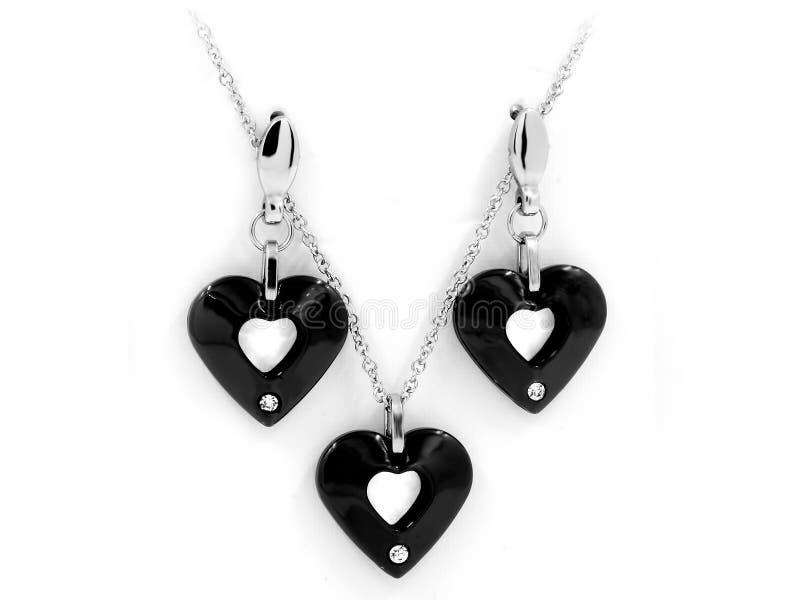 Smyckenuppsättning - halsbandet och örhängen - rostfritt stål och Zircons royaltyfri foto