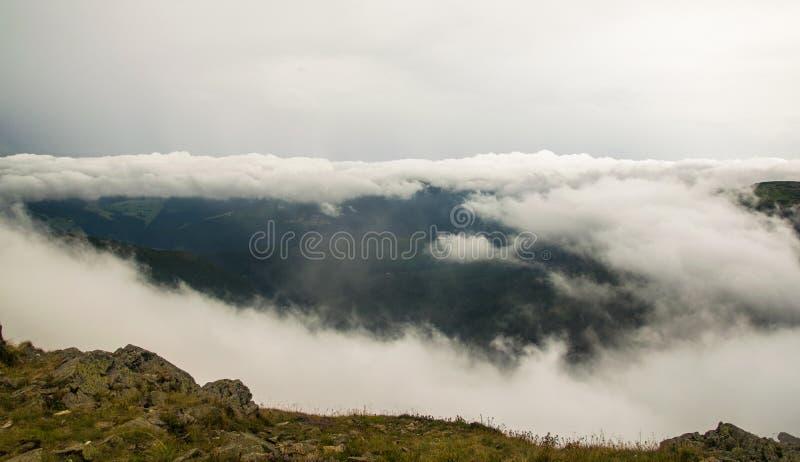 SnÄ›žka - View at cloudy mountains. In Krkonoše, Czech republic royalty free stock photo