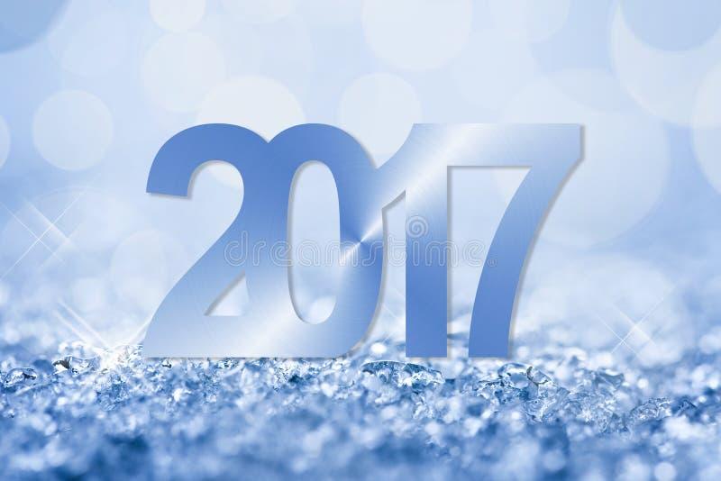 snö för 2017 blått och bokehhälsningkort royaltyfri bild