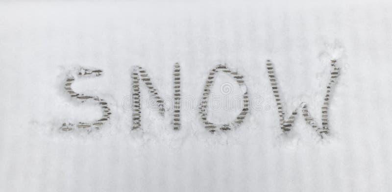 Snö för handskrifttextbokstäver royaltyfri fotografi