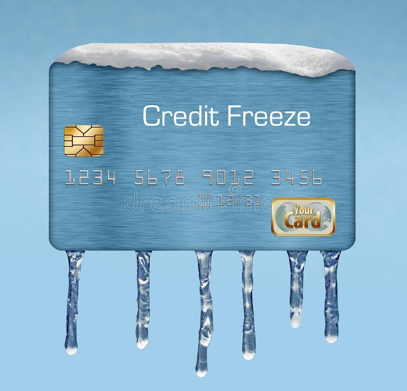 Snö och is på en kreditkort illustrerar temat av att sätta en frysning på din kreditupplysning arkivbilder