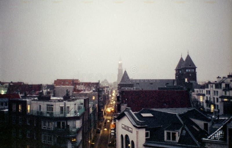 Snö på tak i Amsterdam royaltyfri fotografi