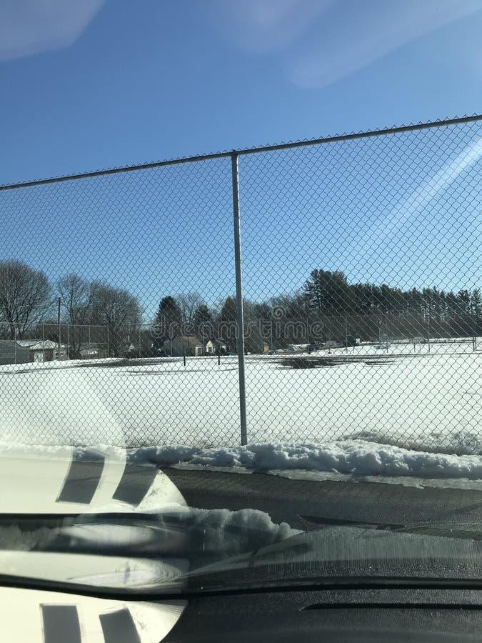 Snö på tennis arkivbilder