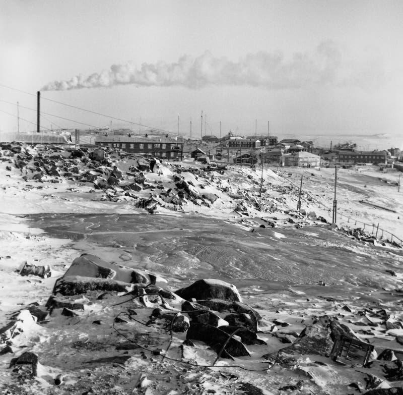 Snö-täckt ö av Dikson, Krasnoyarsk Krai royaltyfria foton