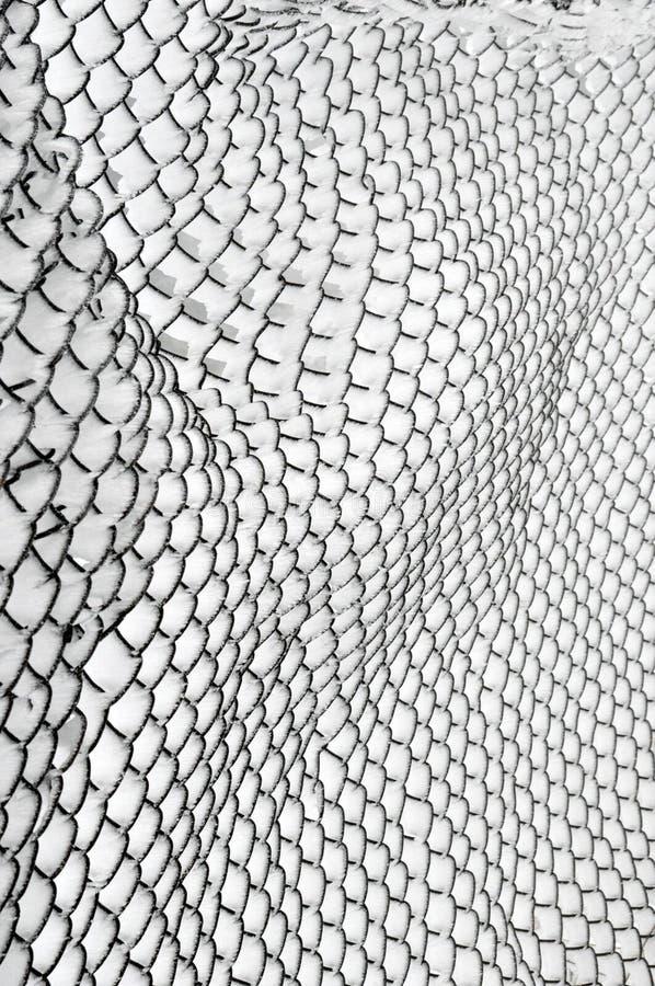 Snö täckt staket för Chain sammanlänkning arkivbilder
