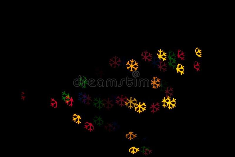 Snöflingabokeh, färgrikt abstrakt begrepp royaltyfri fotografi