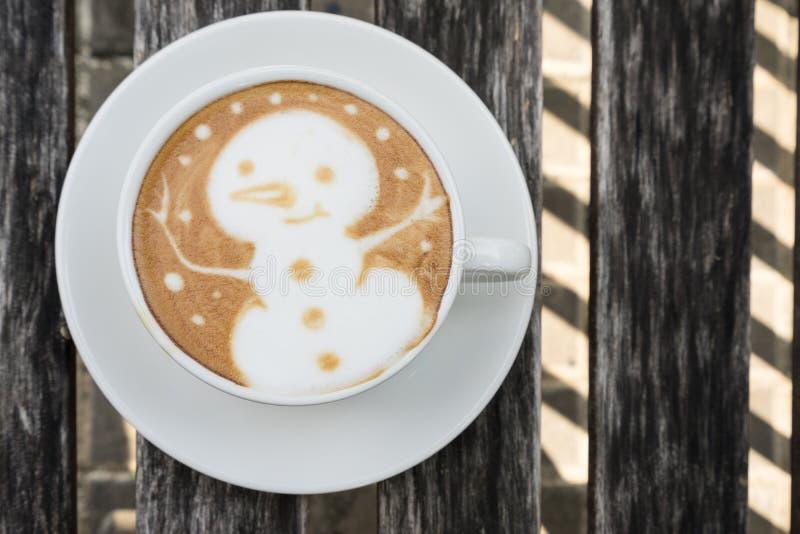 SnögubbeLatte Art Coffee royaltyfri bild