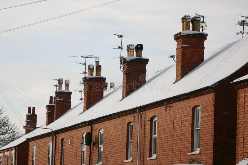 snöig rooftops royaltyfria bilder