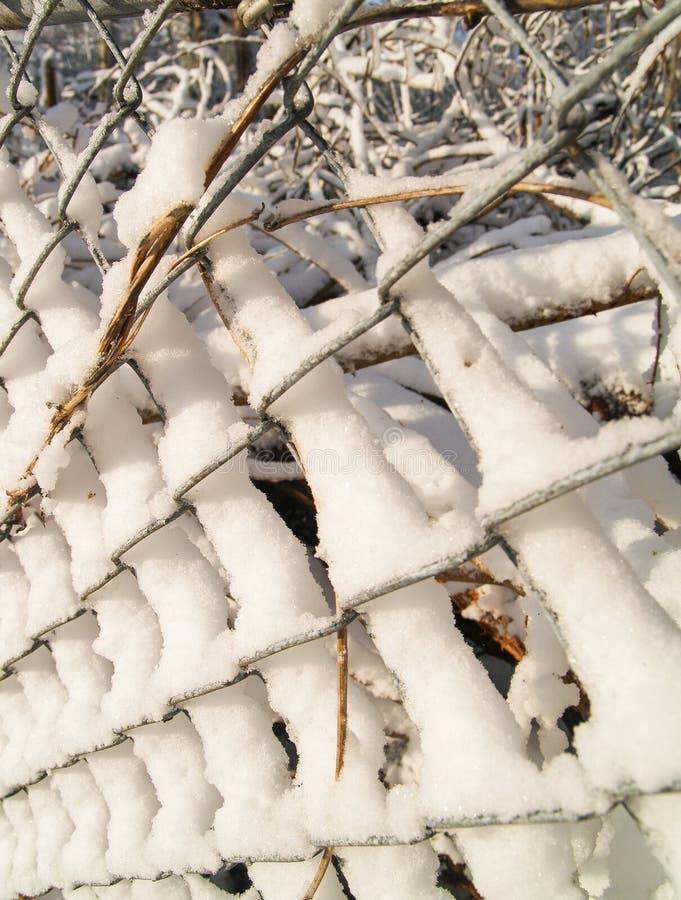 Snöpinnar till ett staket för kedjesammanlänkning royaltyfri bild