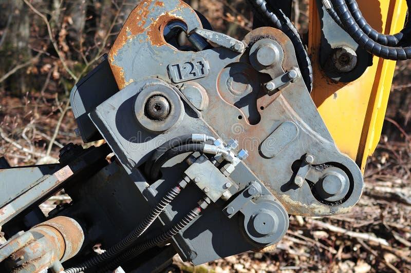 Snabb koppling av en hydraulisk grävskopa royaltyfri bild
