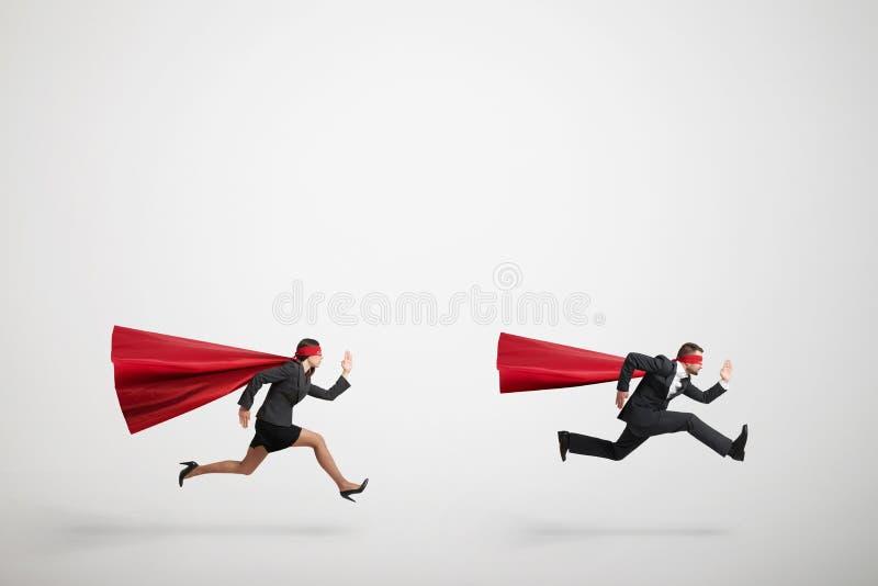 Snabb spring för stålman och för superwoman royaltyfri foto