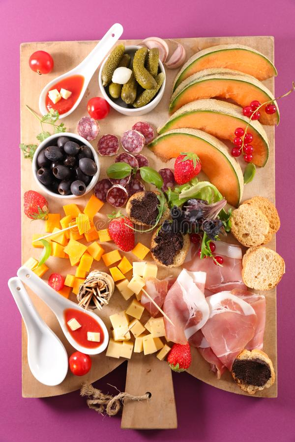 Snack and antipasto. Assorted snack and antipasto on board royalty free stock photo