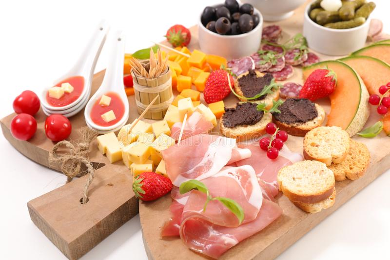 Snack and antipasto. Assorted snack and antipasto on board royalty free stock photography