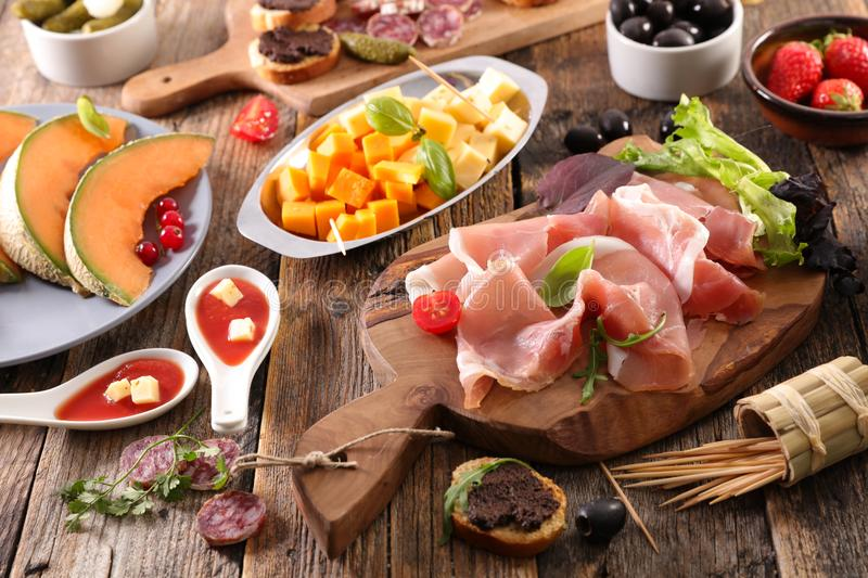 Snack and antipasto. Assorted snack and antipasto on wood royalty free stock image