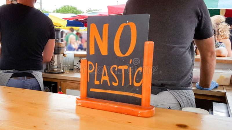 Snack bar sign say no to plastic straw tubes bag bottle cup to save the earth and ocean royalty free stock photography