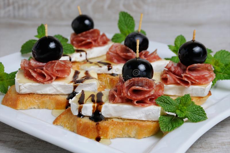Snack with Cheese Brie and salami stock photos